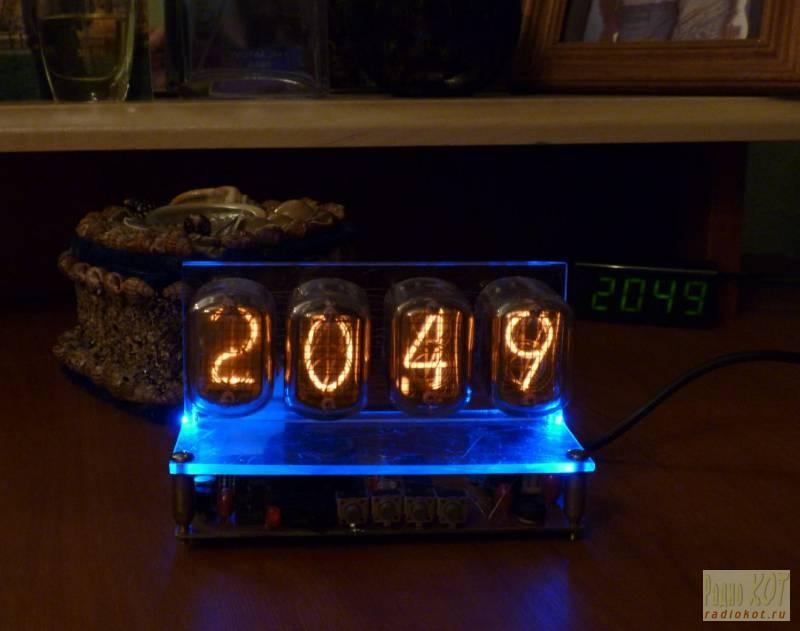 В ход пошло оргстекло.  Часы построены на микросхеме К176ИЕ18.  Ее особенность в том, что выходы T1—T4 выполнены с...